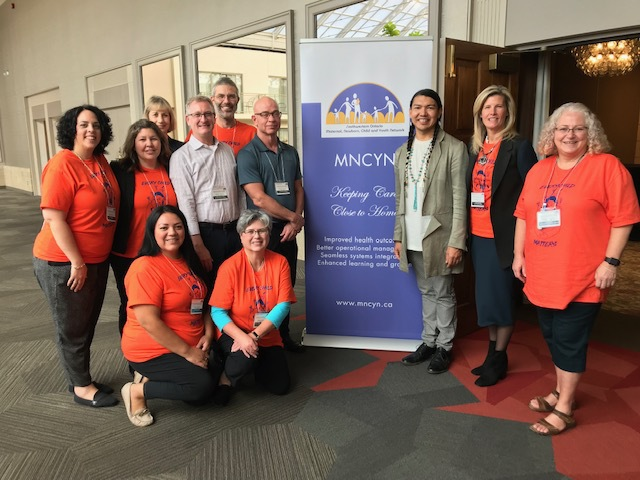 Dr. James Makokis, keynote speaker, with MNCYN team